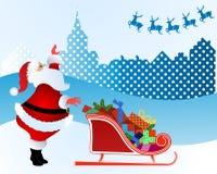 Jultomten som vinkar till hans ren Royaltyfria Bilder