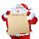 Jultomten som visar hans lista Royaltyfri Fotografi