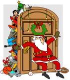 Jultomten välfyllda garderob Fotografering för Bildbyråer