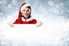 Jultomtenflicka med ett tomt baner Royaltyfri Foto
