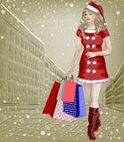 Jultomtenflicka med jul som shoppar packar på cit Arkivbild