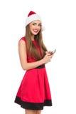 Jultomtenflicka som överför textmeddelandet Royaltyfri Fotografi