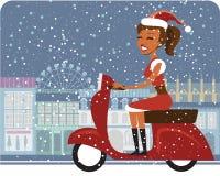 Jultomtenflicka som kör sparkcykeln Arkivfoton
