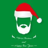 Jultomtenhatt och skägg på grön bakgrund med skugga Arkivbilder