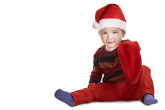 Jultomtenpojke med en tom julstrumpa Royaltyfri Foto