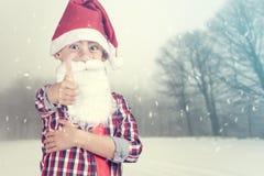 Jultomtenpojke på en vinterbakgrund Royaltyfri Foto