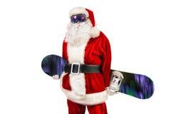 Jultomtensnowboarder Fotografering för Bildbyråer