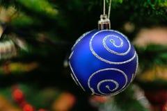 Jultoy på en förgrena sig Royaltyfri Bild