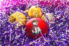 Jultoys och glitter. Arkivbilder