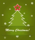 jultree med en röd stjärna på green Fotografering för Bildbyråer