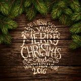 Jultypografi på trätextur Royaltyfria Bilder