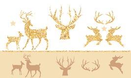 Juluppsättningen av guld blänker renen Arkivfoto