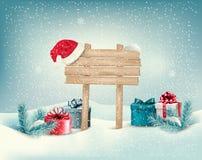 Julvinterbakgrund med gåvor och trä Royaltyfri Bild