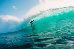 July 29, 2018. Bali, Indonesia. Surfer Ride On Barrel Wave. Professional Surfing In Ocean At Big Waves Stock Photography