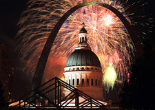 July 4 Fireworks at St Louis Arch. July 4 Fireworks at St Louis with Arch and red fireworks royalty free stock images
