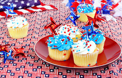 July 4th cupcakes and decorations. Royalty Free Stock Images
