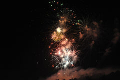 July 4th Fireworks Display. Colorful July 4th Fireworks display against the dark sky Stock Photography