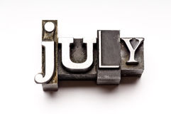 July. The month of July done in letterpress type on a white paper background