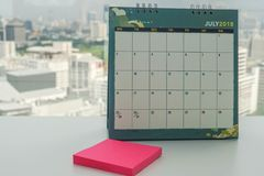 July 2018 calendar with mock up postit for reminder message. And meeting Stock Photography