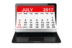 July 2017 calendar over laptop screen. 3d rendering. 2017 year calendar. July calendar over laptop screen on a white background. 3d rendering Royalty Free Stock Photography