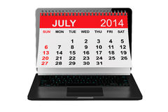 July calendar over laptop screen. 2014 year calendar. July calendar over laptop screen on a white background Royalty Free Stock Image