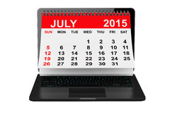 July 2015 calendar over laptop screen. 2015 year calendar. July calendar over laptop screen on a white background Royalty Free Stock Images