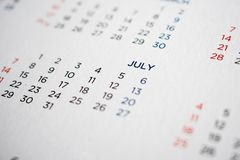 July calendar page with months and dates. Close up stock photography