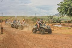 July 2014. Casela natural park,Mauritius,Africa. Start of group quad bike safari adventure trip on a cloudy day.Sugarcane fields stock image