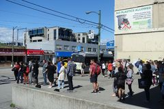 Commuter`s line-up in 99 B-line bus stop Vancouver royalty free stock photo