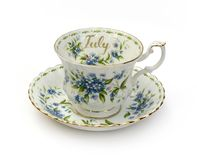 July Cup and Saucer -. Month of July - Forget-Me-Nots royalty free stock photography