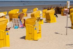 Yellow beach chairs on a sandy beach royalty free stock photo