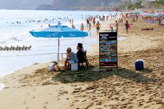 July, 2017 - Employees of the `Havana Club` expect the arrival of a motor boat on the Cléopatra Beach Alanya, Turkey.  Stock Photo