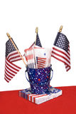 July Fourth napkins and American flags Stock Images