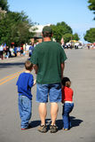July Fourth Parade. A grandfather with his two grandchildren waiting for the July fourth parade to begin. Taken in Frankfort, Michigan royalty free stock images