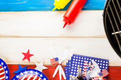 July fourth. Table set with white, blue and red decorations for July 4th barbecue Royalty Free Stock Image