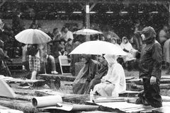 11 JULY 2013 - GARANA, ROMANIA. Scenes and people sitting or walking on the street in a rainy day Stock Images