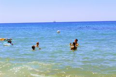 July, 2017 - A group of young people playing ball in the water at Cleopatra Beach Alanya, Turkey stock images
