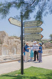 July 30, - Information signs and a group of tourists in the ancient Byzantine park in Caesarea - Caesarea 2015 in Israel. Stock Photography