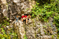 July 2015, Langkawi, Malaysia - Local children at a waterfall royalty free stock photos