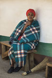 04 July, 2015 - Lesedi, South Africa. Woman Bantu Sesotho next to her house. Stock Photos