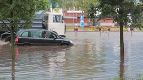 JULY 20 2016 MINSK, BELARUS Flood on a busy road in the city streets after rain. broken car standing amidst the water. JULY 20 2016 MINSK, BELARUS Flood on a stock video