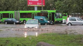 JULY 20 2016 MINSK, BELARUS Flood on a busy road in the city streets after rain with sound. City transport passes by the camera stock video footage