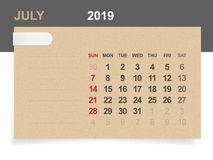 July 2019 - Monthly calendar on brown paper and wood background. Stock Illustration