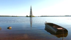 July morning on the Uglich reservoir. Kalyazin, Russia. July morning on the Uglich reservoir. View of the flooded belfry of St. Nicholas Cathedral. Kalyazin stock footage