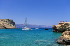 July 22nd 2014 - Sailing yachts anchored in a gulf in Ano Koufonisi island, Cyclades, Greece Royalty Free Stock Images
