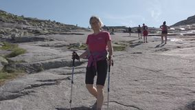 July 26, 2019. Norway tourist route on the trolltunga. People tourists go hiking in the mountains of Norway in fine stock footage