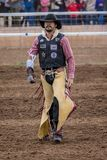 JULY 18, 2017 NORWOOD COLORADO - Cowboy with chinks walks across San Miguel Basin Rodeo, San.  People,  dangerous. JULY 18, 2017 NORWOOD COLORADO - Cowboy with Stock Photos