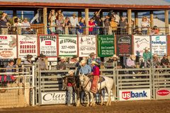 JULY 22, 2017 NORWOOD COLORADO - Cowboys and cowgirls ride before viewing stand at San Miguel.  Rider, Action Stock Photos