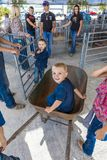 JULY 22, 2017 NORWOOD COLORADO - Little boy in wheel barrel at San Miguel Basin Rodeo, San Miguel.  Fearless,  championship. JULY 22, 2017 NORWOOD COLORADO Stock Photo