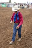 JULY 22, 2017 NORWOOD COLORADO - older cowboy walks at San Miguel Basin Rodeo, San Miguel County.  Dirt,  Motion. JULY 22, 2017 NORWOOD COLORADO - older cowboy Royalty Free Stock Photography